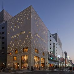 Aoki Jun and Associates complete perforated monogrammed facade for Louis Vuitton Tokyo