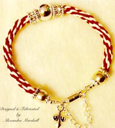 """Love this red and white leather braided rope bracelet with crystal & antique silver (fill & plate) embellishment by Alexandra Marshall. Magnetic clasp w/ safety chain and fleur de lys charm. 7"""" long. Great stacking piece! #B804. $49."""