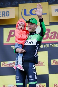 Lars Boom of the Netherlands and team Belkin Pro #Cycling holds his daughter Kee after winning the fifth stage of the 2014 Tour de France