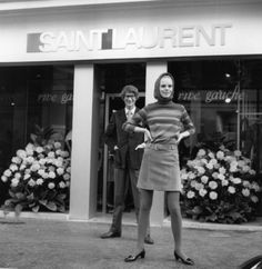 Standing outside the first Saint Laurent Rive Gauche boutique in 1966.