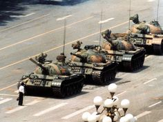"The most iconic image of the Tiananmen Square massacre, this picture depicts the important ""unknown rebel"" standing in front of the tanks that threatened a peaceful protest in China. Jeff Widener snapped this image."