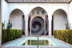 General view of a inner courtyard from Alcazaba. In the foreground a decorative pool, on the background two columns and three arches. Hedge on lateral sides. Malaga Spain, Moorish, Hedges, Columns, Arches, Fountain, Stock Photos, Architecture, Interior