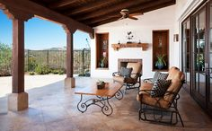 spanish white stucco with wood covered pattio | Spanish Style Patios