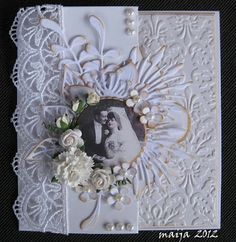 A little too much for me, but love the full page embossing with the lace