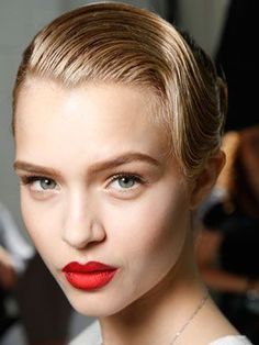 We see red lips every season, but the wine-hued version makeup artist Diane Kendal created for Jason Wu may be one of the coolest takes on the classic beauty look. Kendal used five different products to create an ombr-like effect. Here's how. | allure.com