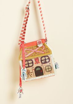 Moral of the Storybook Bag. Theres a lesson to be learned from toting this gingerbread house crossbody bag by Disaster Designs - its the most adorable piece in your collection! #red #modcloth
