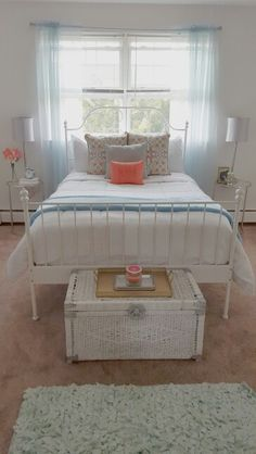 White bedroom with pops of blue and coral! End tables from Ross Bed from Ikea Pillows from HomeGoods Grey pillow was a DIY DIY chest from thrift shop (painted) Tray from Biglots Bedding from Ross Rug from Ross