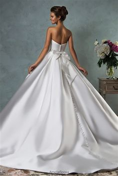 #Wedding Dresses & Bridal Gowns ♥ 2016 is a Gorgeous Princess Satin Ball Gown with a Dipped Strapless Neckline, Satin Fitted & Boned Bodice with Lightly Padded Bust Cups, Crystal Beaded Satin Belt at Natural Waistline, Pleated Satin Ball Gown Skirt, Chapel Train, Back Covered Buttons and Large Satin Bow. #feminine #ballgown #satinweddingdress #straplessweddingdress #satinballgown #beautifulbride #bridalgown #chapel #beadedwaist #princess #dreamwedding #2016weddingdress #sayyestothedress…