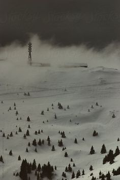 Ski resort and mountain Kopaonik in Serbia during heavy storm. Dark day, fog and heavy clouds are covering mountain peak. You can license this photo exclusively at Stocksy United.
