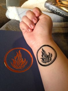 Didn't think someone would already have a divergent tattoo.