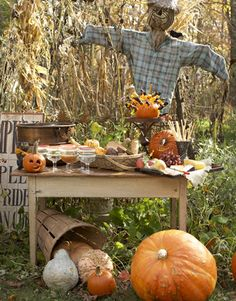 A not-so-scary scarecrow welcomes guests with drinks and appetizers.