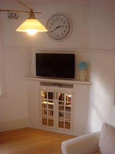 corner fireplace converted to built-in cabinetry & media