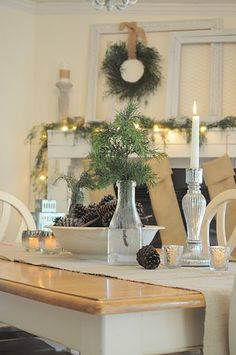 I have those mercury glass candlesticks and love them. Also loving this simple Christmas.