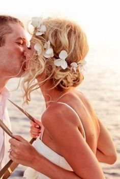 Beach wedding hair. I like the flowers in the hair