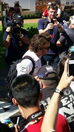 Fernando Alonso signs autographs