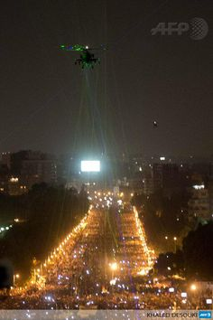 Droves of Protesters in Egypt Aim Laser Pointers at Military Helicopter - | Intellihub.com