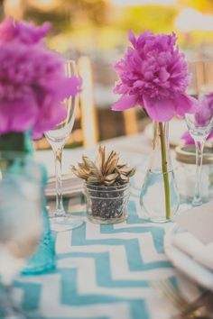 Teal chevron table runner with fuchsia flowers and gold succulent wedding decor.