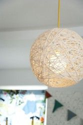 yarn chandelier!!! I ABSOLUTELY WANT!!! I could hang these (without the lights) from the trees!!! <3 adorable!!! :)