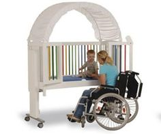 An accessible crib.  >>> See it. Believe it. Do it. Watch thousands of spinal cord injury videos at SPINALpedia.com