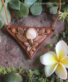 www.forestspiritjewelry.com #franjipani #necklace #apoxie #forestspiritjewelry #handmade #leather #pretty #boho #fashion #flower #moonstone