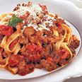 Fettucine with Creamy Tomato and Sausage Sauce...  This is an excellent dish to serve for company. It's fast and easy to prepare, yet tastes like a million bucks. Use any type of pasta you want with this. Our family favorite is Farfalle, or as we call them, Bowties!