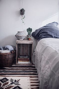 Simple. Turn an old crate on its side for a DIY end table.