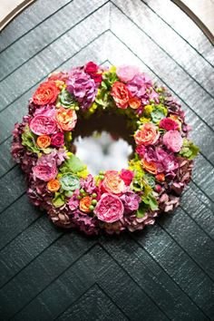 wedding wreath filled with bright blooms