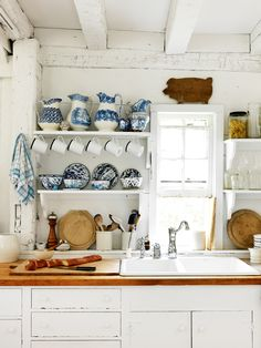 Blue and white ceramics.   Vogue Living — House tour: the idyllic Hamptons cottage of two...