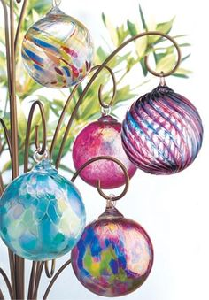 these blown glass balls are not just ornaments they are called kugels and are in folklore said to trap evil spirits at night and hold them until morning light destroyed them(much like Native American dream catchers). Fused Glass, Stained Glass, Leaded Glass, Murano Glass, Glass Ornaments, Christmas Ornaments, Radko Ornaments, Diy Christmas, Dream Catcher Native American