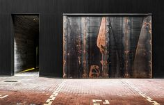 TUVE Boutique Hotel street view entrance with a warehouse-like look and rusty doors.