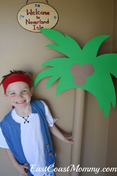 Fun pirate party decor... lots of easy and inexpensive ideas, including this palm tree made from a pool noodle.