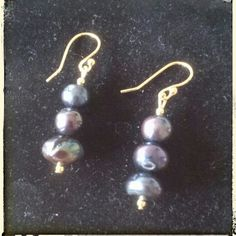 Handcrafted freshwater pearl earrings *NOTE: I make these so if interested do not purchase this listing.  Comment below and I'll create a personalized listing for you!*  Gorgeous genuine black freshwater pearls flanked with gold beads. Pearls have a beautiful vibrant luster with hues of green, blue, and purple.  14k gold plated ball hook wire. Nickel free. Handcrafted. maisondenay Jewelry Earrings