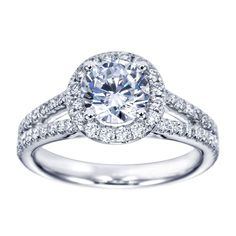 This is a split shank halo engagement ring setting containing 1.50ctw in diamonds and set in platinum.