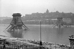 World War 2 hit Hungary hard – photo of a badly damaged Chain Bridge with Buda Castle in the distance Hard Photo, Buda Castle, War Image, Most Beautiful Cities, World War Ii, Hungary, Old Photos, Wwii, Paris Skyline
