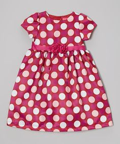 This party-ready frock will have girls ready to dance the night away! A large polka dot print and full silhouette look supremely girly-glam, while the pink rosettes at the waist add a pop of pretty.