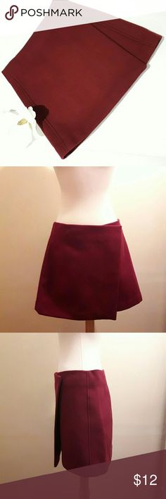 "Uniqlo wool burgundy wrap  skirt ♡ Color: Burgundy  ♡Length: ~15.5 ""  ♡Waist:~28-29""    ♡Pre-owned; great condition, no stain, tear, or rips.  ♡Due to studio lighting, product be may lighter or darker in pictures. ♡ Bundle 2 or more items in my closet to save 10% and pay only ONE shipping fee!!!  #11 Uniqlo Skirts Mini"