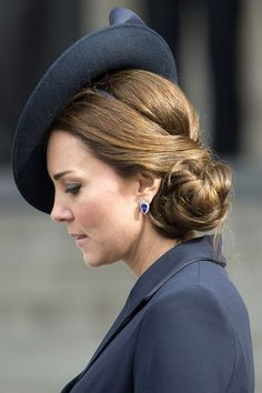 Kate's hair was styled in an intricately woven updo, pinned to one side, as she attended the Service of Commemoration at St Paul's Cathedral, March 13, 2015.
