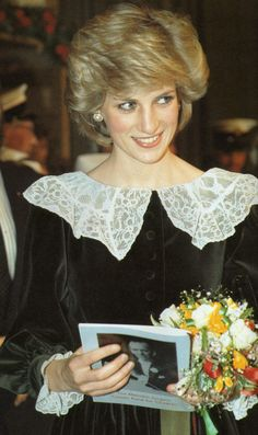 Diana in classic black velvet with lace collar