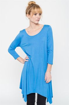 Soft + drapey knit tee dress with a raw-edge, and an asymmetrical hem from our signature line. Cut in a swingy silhouette with allover seaming detail, a rounded neckline and a quarter sleeve length.COLORS: BlueMochaBlushRoyalNavyTaupeBlackHeather GreyOatmealCharcoalThis garment runs true to size:SIZES:Small (0-4)Medium (6-8)Large (10-12)X-Large (14-16)Model is wearing a size Small.95% Rayon, 5% Spandex. Made in USA.
