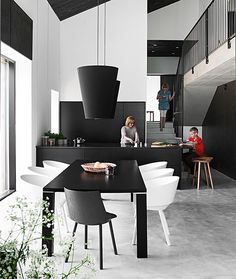 A black kitchen with a high ceiling, Maja house at the Housing Fair in Hyvinkää.