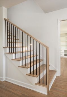 Modern style stairwell design with black rods and custom natural stain. Modern style stairwell design with black rods and custom natural stain. Interior Stair Railing, Modern Stair Railing, Stair Railing Design, Home Stairs Design, House Design, Modern Stairs Design, Black Railing, Cable Railing, House Staircase