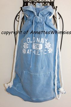 UPcycled sweatshirt drawstring athletic bag by annetteswhimsies, 25.00...bag measures 12x16 not counting the hood...cord is white cotton...recycled item handmade...great job...love it :)