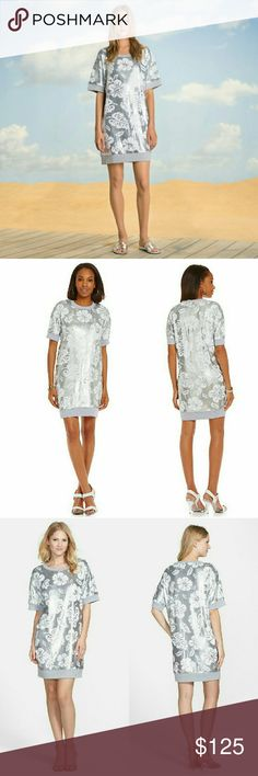 New! MICHAEL KORS Sequin Short Sleeve Shift Dress Every move you make will sparkle when you wear this sequin floral pattern sweater dress from MICHAEL?Michael?Kors.?A tropical design formed from silvery and white sequins brings lux shimmer to an easy short-sleeve shift, while the lightweight French-terry knit makes the inside very comfortable.  Allover floral sequin design on French terry knit fabric Knit fabric at neckline, hem and sleeves Pullover style. Short sleeves Approximately 35…