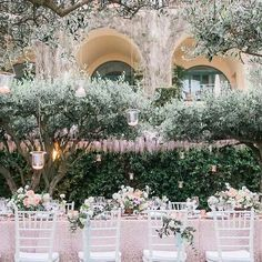"""""""Isn't this setting magical? With olive trees, a pink glittery tablescape, and Belmond Hotel Caruso off the #AmalfiCoast, there's no shortage of details to swoon over in Leslie + Roy's intimate destination #wedding. @carlagatesphotography captured the elements @evaclarkevents helped them bring together."""" #BelmondWeddings via @100_layercake"""