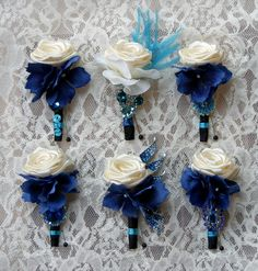 Teal and Sapphire royal blue jeweled wedding boutonniere. Made to order. $30.00, via Etsy.