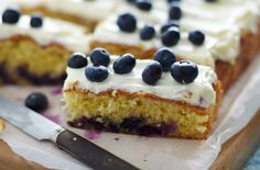 Finish the perfect meal with this delicious blueberry traybake with lemon icing recipe. Find this recipe and hundreds of other desserts at Tesco Real Food today! Lemon Icing Recipe, Lemon Cream Cheese Icing, Baking Recipes, Real Food Recipes, Dessert Recipes, Brownie Recipes, Vegetarian Recipes, Yummy Food, Icing Ingredients
