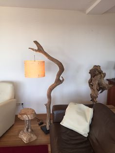 Floor lamp and arc lamp made of weathered old Oak branch on black natural stone base,