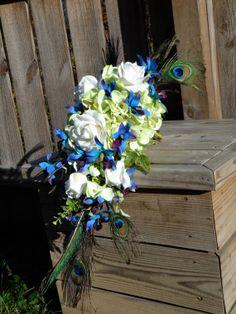 Purple blue orchid bouquet, hydrangeas, roses, peacock feather bouquet , dendrobium orchids  Ask a Question $130.00