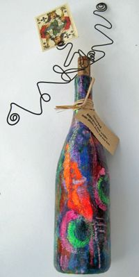 photo holder from wine bottle, paper towels and paint.