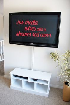 You won't believe how simple this idea is!! HIde wire clutter with a cheap shower rod cover!